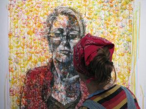 Kristin Pluhacek profile image - in studio working on Conflict